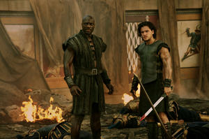 "Adewele Akinnouye-Agbaje as Atticus and Kit Harington as Milo in ""Pompeii."""