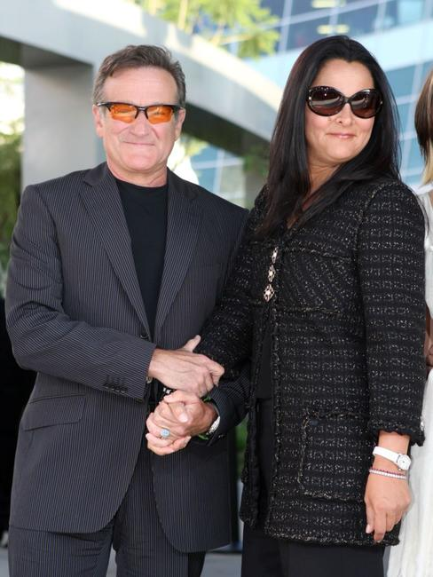 Robin Williams and his wife Marsha Garces Williams at the premiere of the film