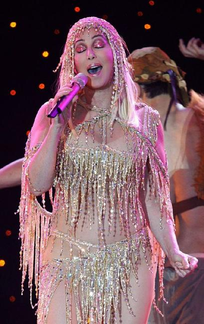 Cher performs on stage during her