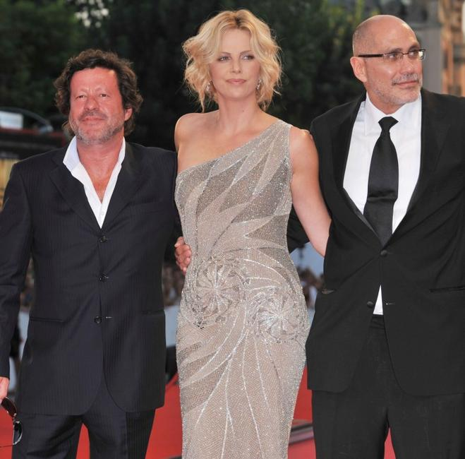 Joaquim de Almeida, Charlize Theron and Director Guillermo Arriaga at the premiere of