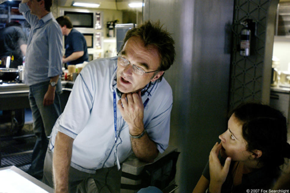 Director Danny Boyle and Rose Byrne on the set of