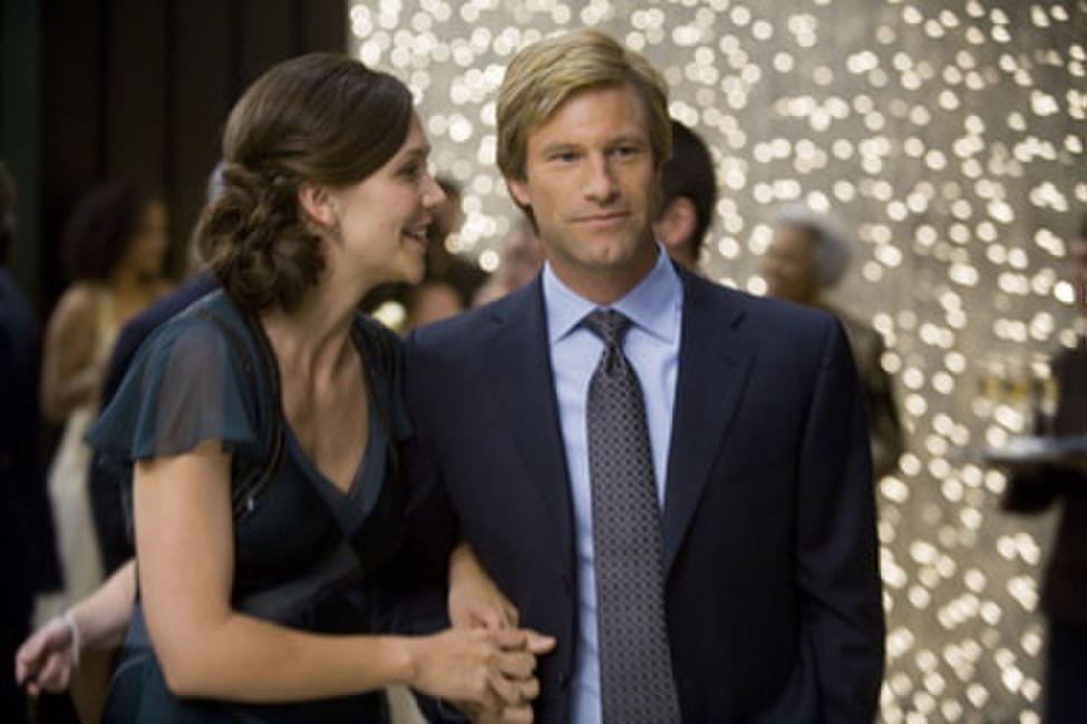 Maggie Gyllenhaal and Aaron Eckhart in