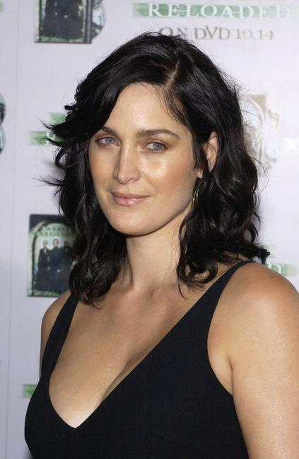 Carrie-Anne Moss at the launch party for the worldwide DVD release of