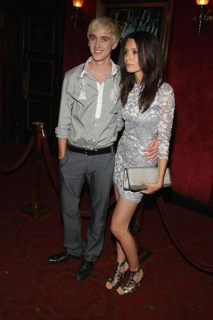 Tom Felton and Guest at the premiere of