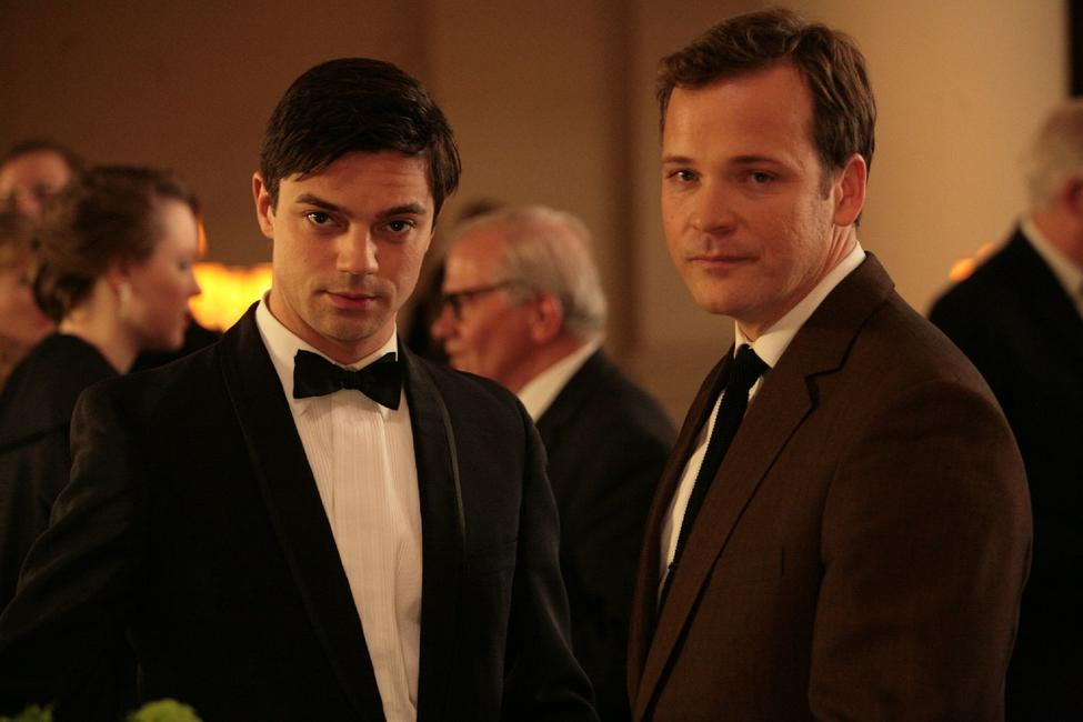 Dominic Cooper as Danny and Peter Sarsgaard as David in