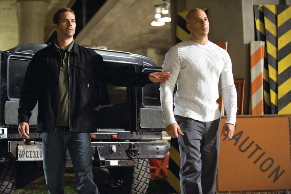 Paul Walker as Brian O'Conner and Vin Diesel as Dom Toretto in