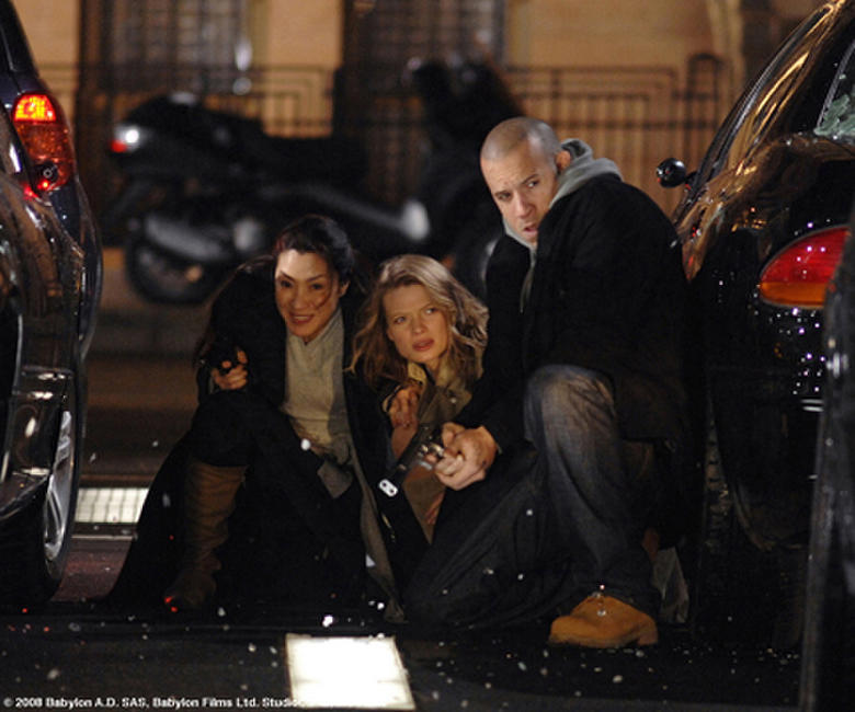 Sister Rebeka (Michelle Yeoh, left), Aurora (Melanie Thierry) and Toorop (Vin Diesel) are caught in a gunfight on a New York City street in