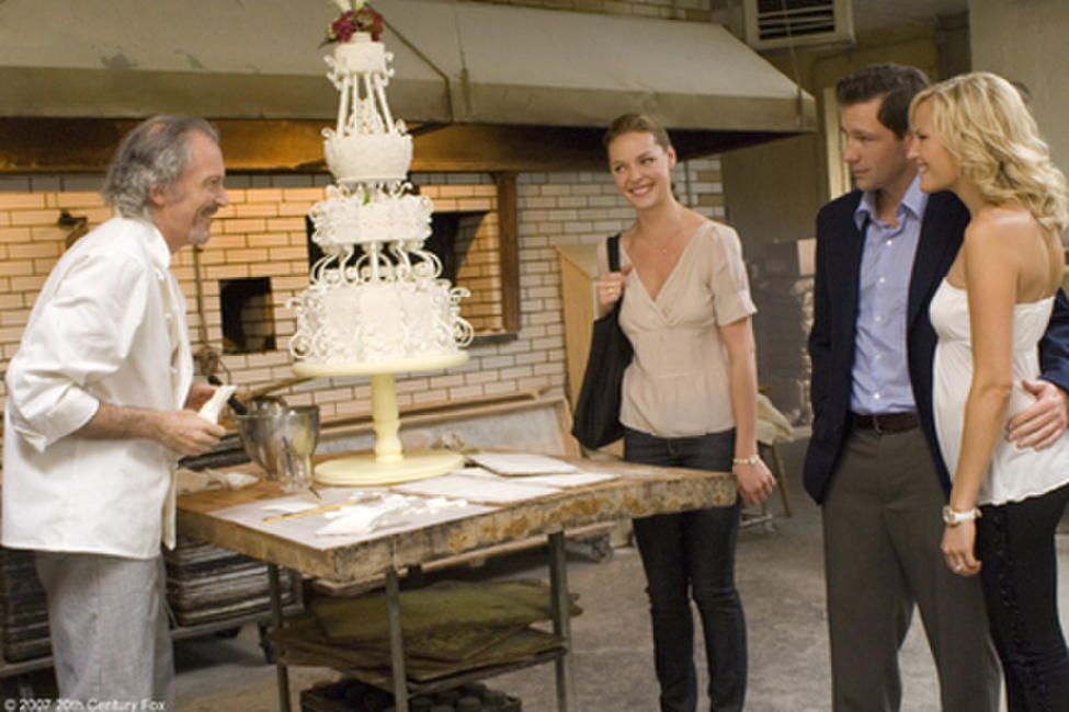 Jane (Katherine Heigl, center), and engaged couple George (Edward Burns) and Tess (Malin Akerman), marvel at the creation of master baker Antoine (Ronald Guttman) in
