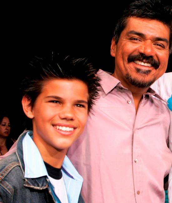 Taylor Lautner and George Lopez at the premiere of