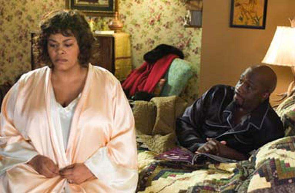 Shelia (Jill Scott) and her husband Mike (Richard T. Jones) in