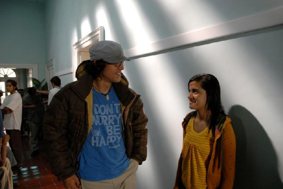 Writer/director Cary Joji Fukunaga and Paulina Gaitan on the set of