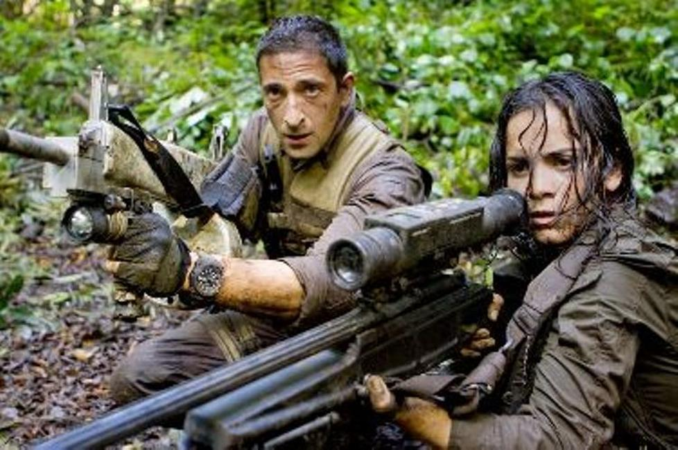 Adrien Brody as Royce and Alice Braga as Isabelle in
