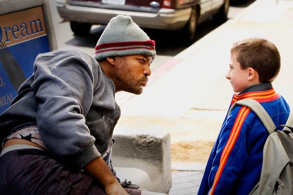 Will Smith as Hancock and Atticus Shaffer in