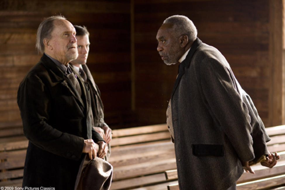 Robert Duvall as Felix, Lucas Black as Buddy and Bill Cobbs as Rev. Jackson in