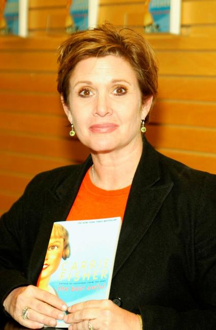 Carrie Fisher signs copies of her book The Best Awful.