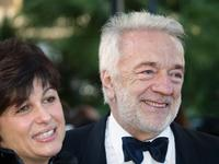 Jean-Pierre Cassel and his wife at the palais des festivals at the screening of