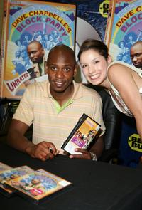 Dave Chappelle and Cassandra Leyva at the signing of DVD copies of