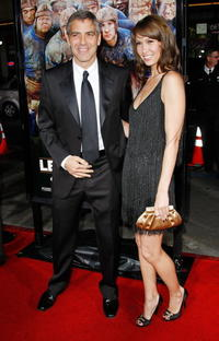 Actor/director George Clooney and model Sarah Larson at the Hollywood premiere of