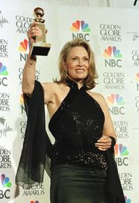Faye Dunaway holds her award at the 56th Annual Golden Globe Awards.