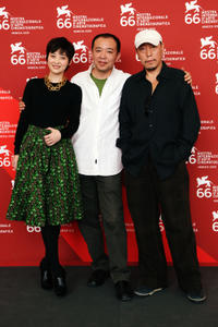 Ting Mei, director Liu Jie and Ni Dahong at the photocall of