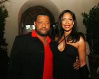 Laurence Fishburne and Gina Torres at the afterparty for the premiere of