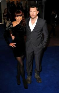 Sam Worthington and Guest at the world premiere of