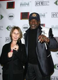 Louis Gossett, Jr. and Guest at the Holiday Toy Drive Fundraising Extravaganza.
