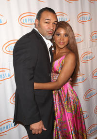 Toni Braxton and Guest at the 9th Annual Lupus LA Orange Ball in California.