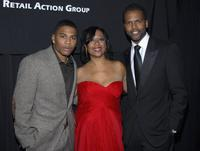Nelly, Gail Monroe-Perry and AJ Calloway at the Black Retail Action Group Awards.