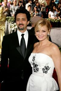 Grant Heslov and Guest at the 78th Annual Academy Awards.