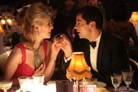 Rosamund Pike as Helen and Dominic Cooper as Danny in