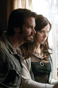 Garret Dillahunt as Krug and Riki Lindhome as Sadie in