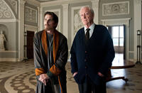 Christian Bale as Bruce Wayne and Michael Caine as Alfred in