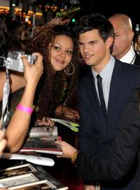 Taylor Lautner and Guest at the California premiere of