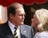 Roger Moore with wife Christina Tholstrup while being honored with a Star on the Walk of Fame.