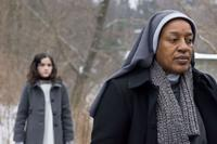 Isabelle Fuhrman as Esther and CCH Pounder as Sister Abigail in