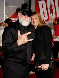 Randy Savage and Guest at the premiere of
