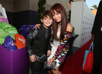 Max Charles and Guest at the Staples, DoSomething.org & Bella Thorne Party.