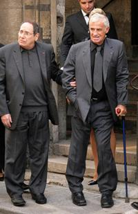 Jean-Paul Belmondo and Robert Hossein at the funeral of French actor and filmmaker Jean-Claude Brialy.
