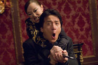 Youki Kudoh and Jackie Chan in