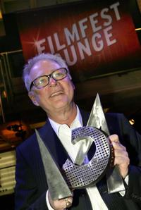 Barry Levinson at the Munich film festival with his CineMerit Award trophy.