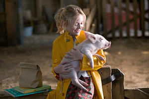 "Fern (Dakota Fanning) gives Wilbur a pig hug in ""Charlotte's Web."""