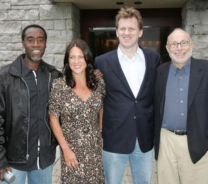 """Actor Don Cheadle, producer Cathy Schulman, director Ted Braun and producer Mark Jonathan at the """"Darfur Now"""" screening during the Toronto International Film Festival 2007."""