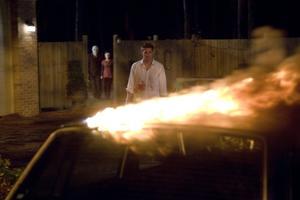 "Kip Weeks, Laura Margolis as Pin-Up Girl and Scott Speedman as James Hoyt in ""The Strangers."""