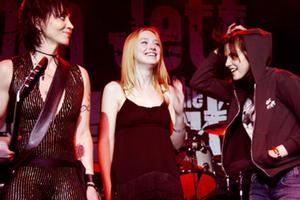 Joan Jett, Dakota Fanning and Kristen Stewart onstage at Jett's concert at Sundance Film Festival 2010.