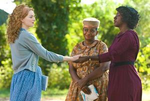 "Emma Stone, Octavia Spencer and Viola Davis in ""The Help."""