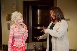 "Dolly Parton as G.G. Sparrow and Queen Latifah as Vi Rose Hill in ""Joyful Noise."""