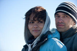 "Halle Berry as Kate and Olivier Martinez as Jeff in ""Dark Tide."""