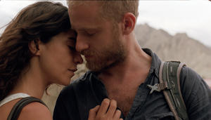 "Lubna Azabal and Ben Foster in ""Here."""