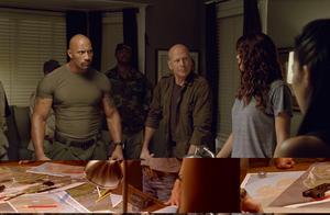 "Dwayne Johnson as Roadblock and Bruce Willis as Colton in ""G.I. Joe: Retaliation 3D."""